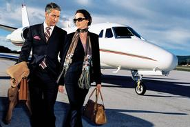 two people walking away from a private plane